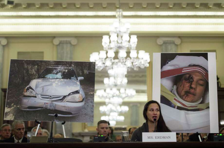 Air Force Lt. Stephanie Erdman, whose eye was injured by airbag shrapnel from her 2002 Honda Civic, is surrounded by pictures showing the accident as she testifies before the US Senate Committee on Commerce, Science, and Transportation on Capitol Hill in Washington, DC, November 20, 2014, on the Takata airbag defects and the vehicle recall process.              AFP PHOTO / Jim WATSONJIM WATSON/AFP/Getty Images Photo: JIM WATSON / AFP/Getty Images / AFP ImageForum