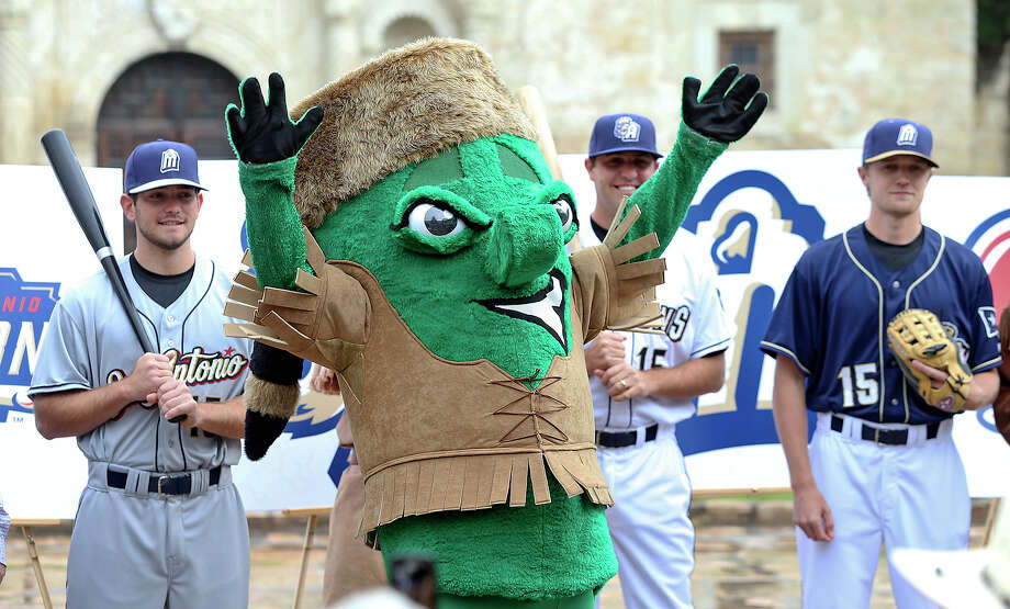 Mascot Ballapeno celebrates his new look as representatives from the San Antonio Missions baseball team announce changes in the team's logo and uniforms. Photo: TOM REEL