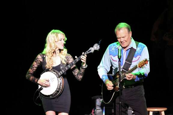 """Ashley Campbell and her father, Glen Campbell, perform on """"The Goodbye Tour,"""" in a scene from """"Glen Campbell: I'll Be Me."""""""