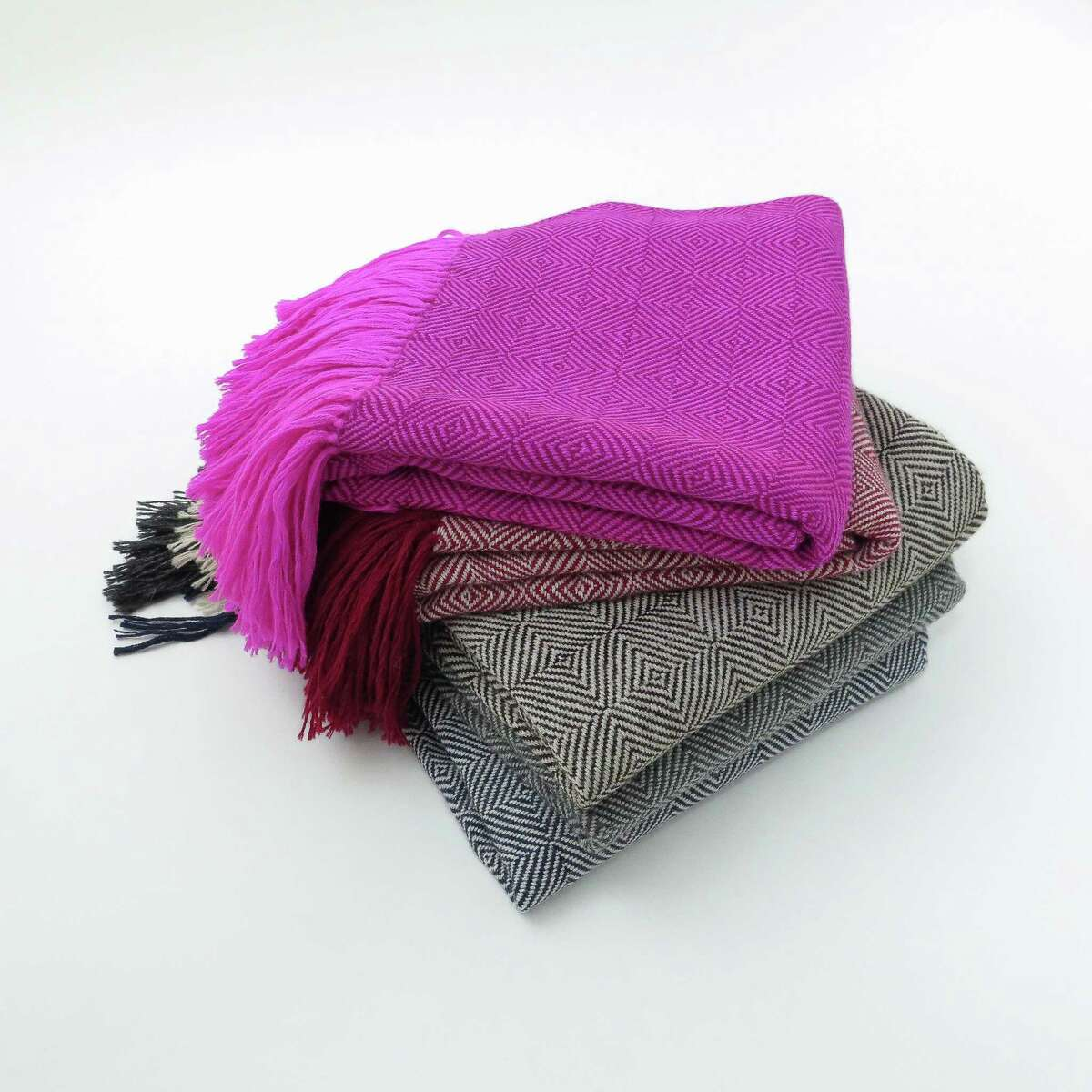 """""""Alpaca and handwoven cotton throws you can throw on your bed or use as a shawl."""" - Erica Tanov, clothing and textile designer and store owner. Alpaca throws, $624 each. shop.ericatanov.com"""