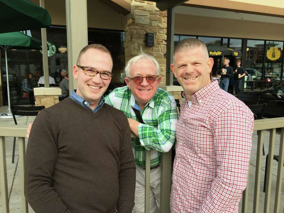 John Daugherty, Realtors' Bryan Beene (left) and his husband Ronald Jones ran into actor, author and playwright Leslie Jordan (center) in Midtown recently.