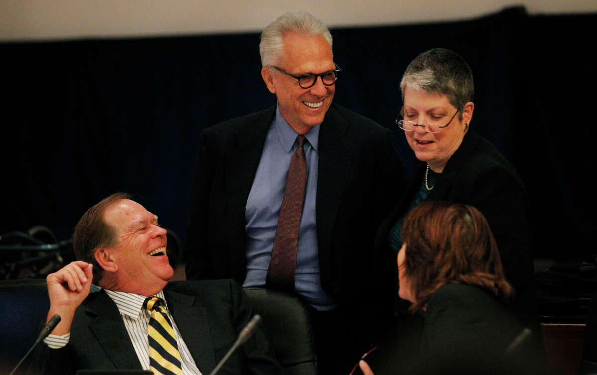 Regents Russell Gould (left), Norman Pattiz, UC President Janet Napolitano and Bonnie Reiss chat as the public enters for their comment part of a closed UC regents meeting at the UCSF Mission Bay campus Nov. 20, 2014 in San Francisco. A lawsuit was filed against Pattiz stating the UC regent brandished a loaded weapon at an employee.