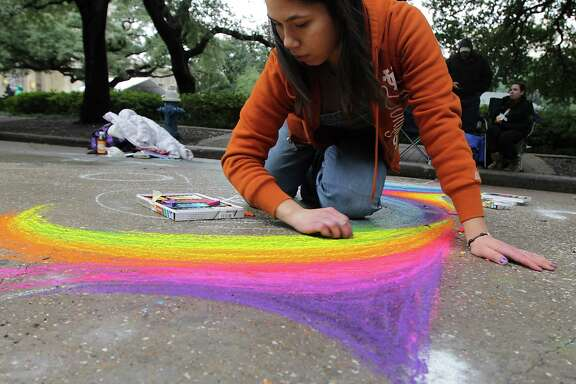 Jacky Cardenas works on her art piece during the Via Colori The Street Painting Festival in downtown Saturday, Nov. 23, 2013, in Houston.  ( James Nielsen / Houston Chronicle )