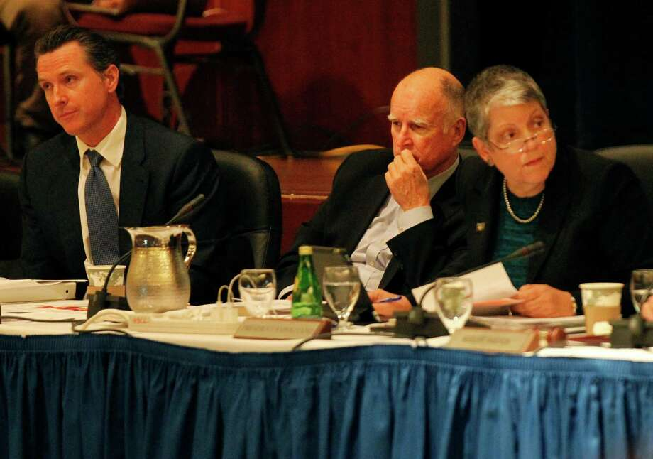 Gov. Jerry Brown (left) and UC President Janet Napolitano listen to chants against tuition hikes during the regents meeting. Photo: Leah Millis / The Chronicle / ONLINE_YES