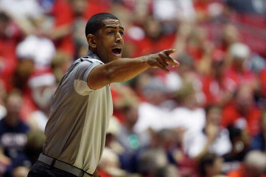 UCONN head basketball coach Kevin Ollie yells out instructions to his players during the first half of an NCAA college basketball game against Charleston in San Juan, Puerto Rico, Thursday, Nov. 20, 2014. (AP Photo/Ricardo Arduengo) Photo: Ricardo Arduengo, Associated Press / Associated Press