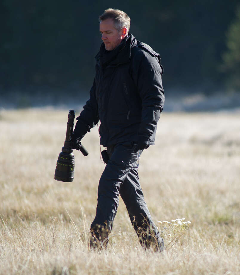 """Wild"" director Jean-Marc Vallee strolls through a field on location. in the Pacific Northwest. Photo: Fox Searchlight / Fox Searchlight / ONLINE_YES"