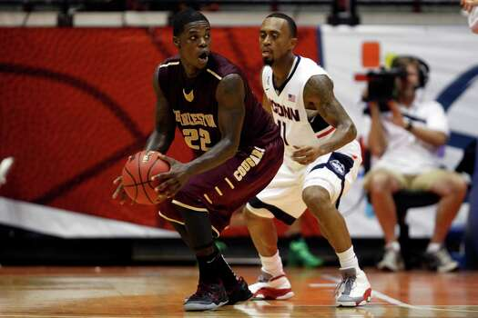 Charleston guard Anthony Stitt looks to pass against the defense of UCONN guard Ryan Boatright, during an NCAA college basketball game in San Juan, Puerto Rico, Thursday, Nov. 20, 2014. (AP Photo/Ricardo Arduengo) Photo: Ricardo Arduengo, Associated Press / Associated Press