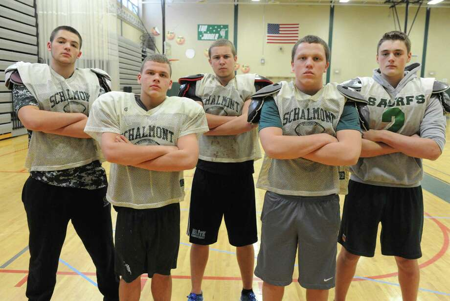 The Schalmont High School football team offensive line, left to right: Austin Wetsel, Shawn Coons, Aaron Smith, Andrew Hewitt and Matt Capavoni on Thursday, Nov. 20, 2014, in Rotterdam, N.Y. (Michael P. Farrell/Times Union) Photo: Michael P. Farrell / 00029564A