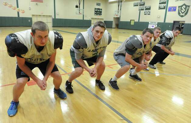 The Schalmont High School football team offensive line, left to right: Aaron Smith, Matt Capavoni, Andrew Hewitt, Shawn Coons and Austin Wetsel on Thursday, Nov. 20, 2014, in Rotterdam, N.Y. (Michael P. Farrell/Times Union) Photo: Michael P. Farrell / 00029564A