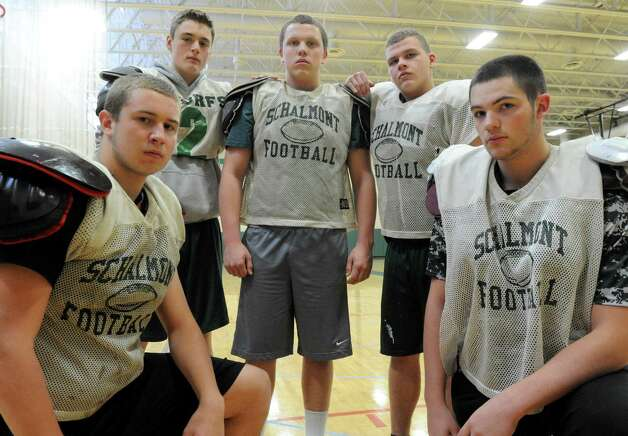 The Schalmont High School football team offensive line, left to right: Aaron Smith, Matt Capavoni, Andrew Hewitt, Shawn Coons and Austin Wetsel on Thursday, Nov. 20, 2014, in Rotterdam, N.Y. (Michael P. Farrell/Times Union) Photo: Michael P. Farrell / Aaron Smith, Andrew Hewitt, Matt Capavoni, Shawn Coons and Austi