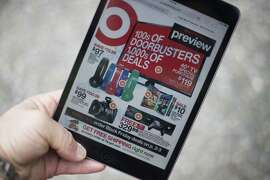 """A """"Black Friday"""" advertisement for Target is seen on an iPad in Annapolis, Maryland November 16, 2014. """"Black Friday"""" is coming early this year to retailers, as many plan to open on November 27, Thanksgiving Day."""