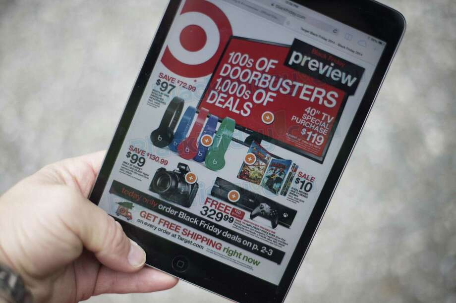 """A """"Black Friday"""" advertisement for Target is seen on an iPad in Annapolis, Maryland November 16, 2014. """"Black Friday"""" is coming early this year to retailers, as many plan to open on November 27, Thanksgiving Day. Photo: JIM WATSON / JIM WATSON / AFP/Getty Images / AFP ImageForum"""