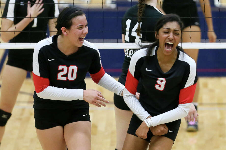 Churchill's Hannah Lopez (left) and Yasmine Ataee celebrate a point during their UIL Class 6A first-round volleyball playoff match victory over Steele at the Alamo Convocation Center on Nov. 4, 2014. Photo: Marvin Pfeiffer /San Antonio Express-News / Express-News 2014