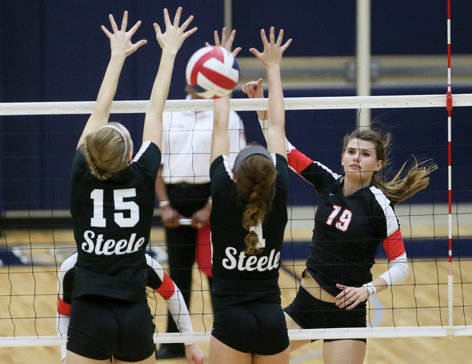Churchill's Cate Buckingham (from right) watches her shot sail past Steele's Abbey Wells and Jessica Stohlmann during their UIL Class 6A first-round volleyball playoff match at Alamo Convocation Center on Nov. 4, 2014. Photo: Marvin Pfeiffer /San Antonio Express-News / Express-News 2014