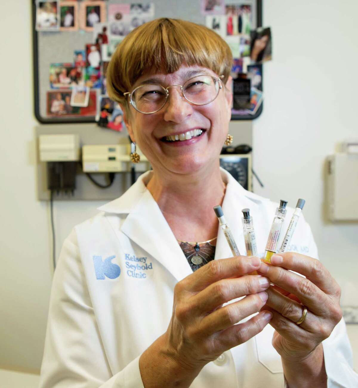 Dr. Melanie Mouzoon holds an array of vaccines at Kelsey-Seybold, Thursday, Nov. 20, 2014, in Houston. (Cody Duty / Houston Chronicle)