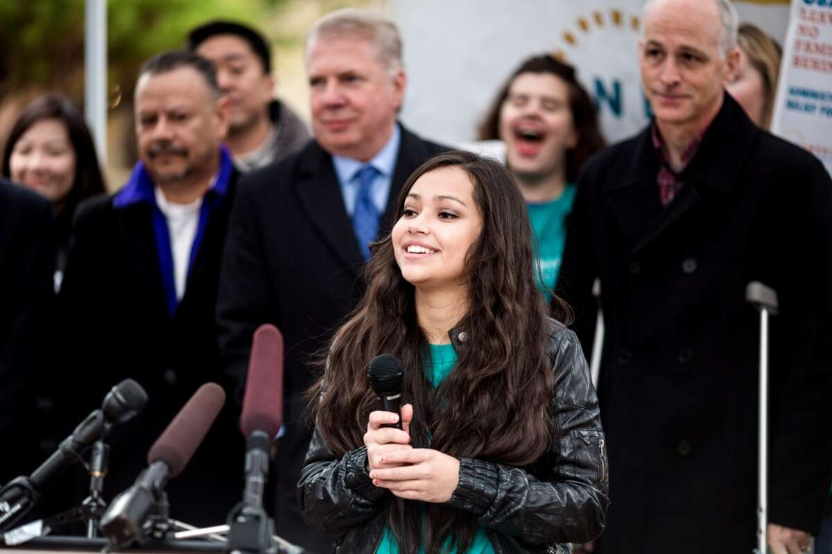 Emcee Maricarmen Garcia speaks during a rally organized by OneAmerica as part of a National Week of Action to demand robust executive measures to stop deportations and keep families together Thursday, November 20, 2014, in Seattle, Washington. (Jordan Stead, seattlepi.com)