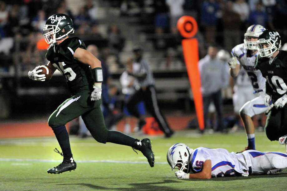 Shen's Matt Taft, left, shakes off a tackle from Saratoga's Robert Haughton on his way to a touchdown during their football game on Friday, Sept. 26, 2014, at Shenendehowa in Clifton Park, N.Y. (Cindy Schultz / Times Union) Photo: Cindy Schultz / 00028776A