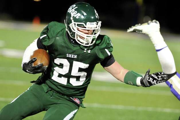 Shen's Matt Taft gains yards during their Class AA Super Bowl against CBA on Friday, Nov. 7, 2014, at Bob Ford Field in Albany, N.Y. (Cindy Schultz / Times Union) Photo: Cindy Schultz / 00029384A