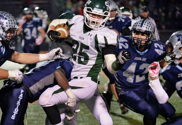 Shen's #25 Matt Taft, center, battles through John Jay-East Fishkill defenders during the Class AA quarterfinal football game at Dietz Stadium Saturday Nov. 15, 2014, in Kingston, NY.   (John Carl D'Annibale / Times Union) Photo: John Carl D'Annibale / 00029472A