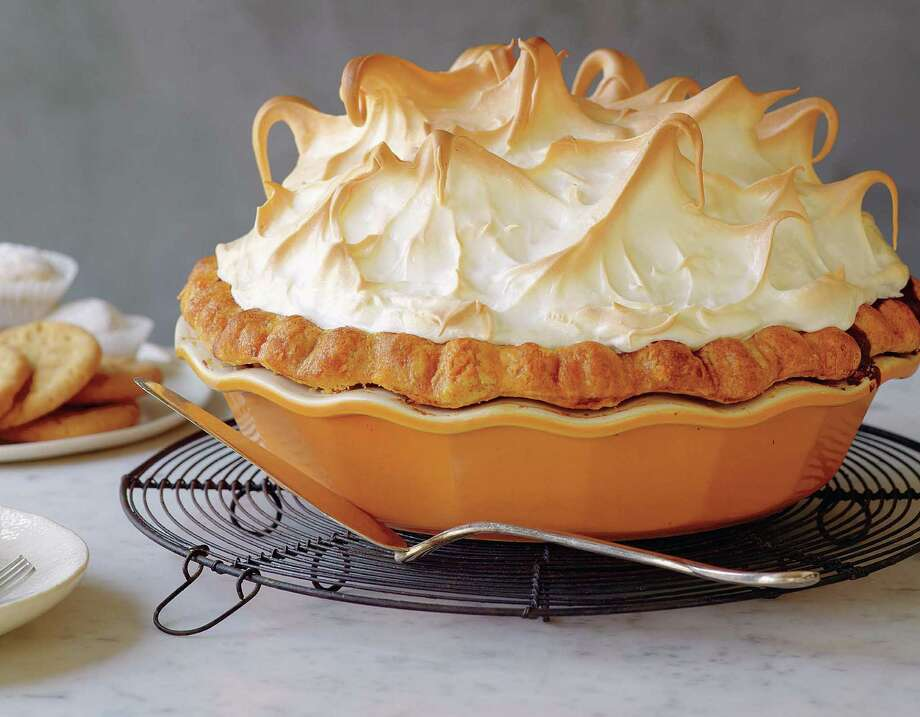 """Pumpkin Meringue Pie from """"Perfect Pies & More. In her book, Michele Stuart also meditates on such things as setting aside time for cookbook comprehension. Photo: Ben Fink / Random House"""