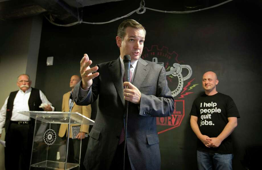 U.S. Sen. Ted Cruz speaks about net neutrality at Capital Factory in Austin, Texas, Friday, Nov. 14, 2014.  Listening are, left to right, Ron Yokubaitis, Co-CEO and Founder of Data Foundry, Bill Moore, CEO of Zello, and Joshua Baer, Founder of Capital Factory.  (AP Photo/Austin American-Statesman, Jay Janner)  AUSTIN CHRONICLE OUT, COMMUNITY IMPACT OUT, INTERNET AND TV MUST CREDIT PHOTOGRAPHER AND STATESMAN.COM, MAGS OUT Photo: Jay Janner, MBO / Austin American-Statesman