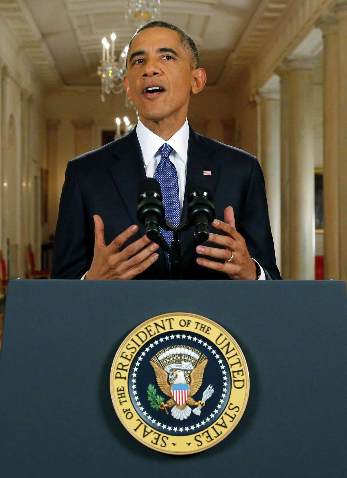 President Barack Obama announces executive actions on immigration during a nationally televised address from the White House in Washington, Thursday, Nov. 20, 2014. Obama outlined a plan on Thursday to relax U.S. immigration policy, affecting as many as 5 million people.