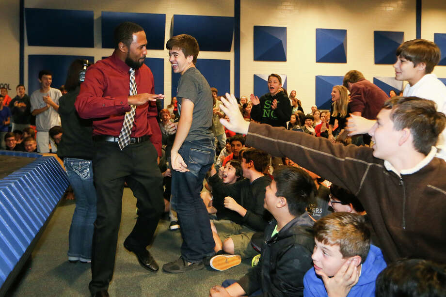Seventh grade science teacher Michael McElrath (left) is congratulated by students on his way to the stage to accept  a $6290.09 award for Dissection Tools and Specimen Equipment won with other science teachers at Alamo Heights Junior School, 7607 N. New Braunfels, on Thursday, Nov. 20, 2014.  MARVIN PFEIFFER/ mpfeiffer@express-news.net Photo: Marvin Pfeiffer, Staff / San Antonio Express-News / Express-News 2014