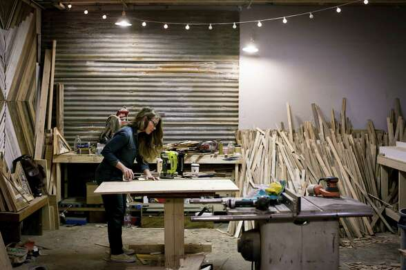 Woodworker Aleksandra Zee works on a commissioned piece in her S.F. workshop.