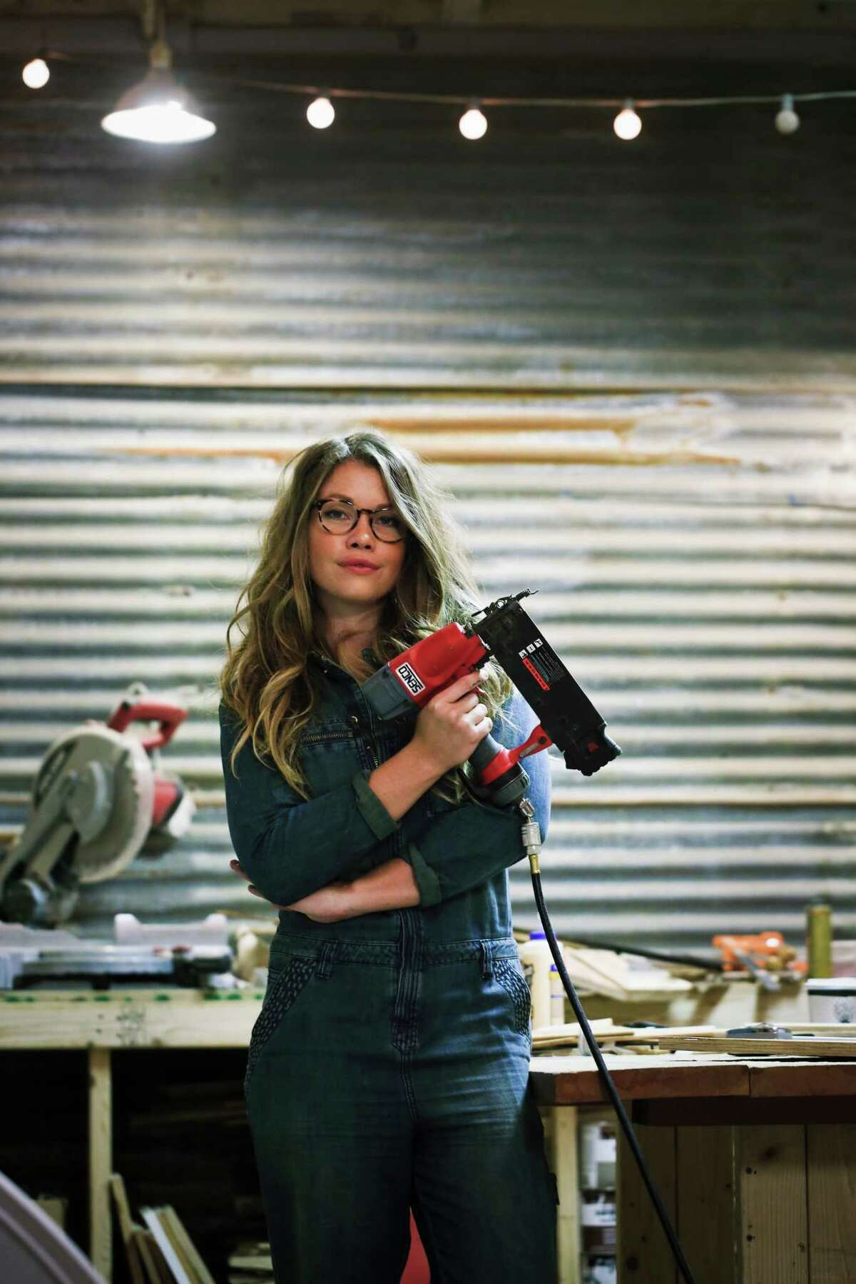 Woodworker Aleksandra Zee with some of the tools of her trade in her S.F. workshop.
