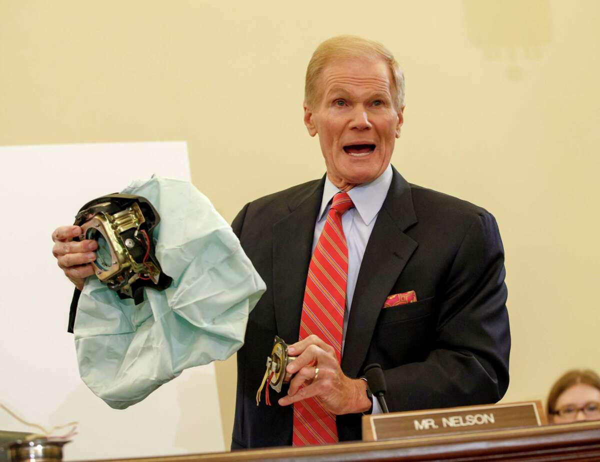 Problem No. 1: Air bags Senate Commerce Committee member Sen. Bill Nelson, D-Fla. displays the parts and function of a defective air bag made by Takata of Japan that has been linked to multiple deaths and injuries in cars driven in the U.S. The panel held a hearing Thursday, Nov. 20, 2014, in Washington. Apologies, but no clear answers for senators