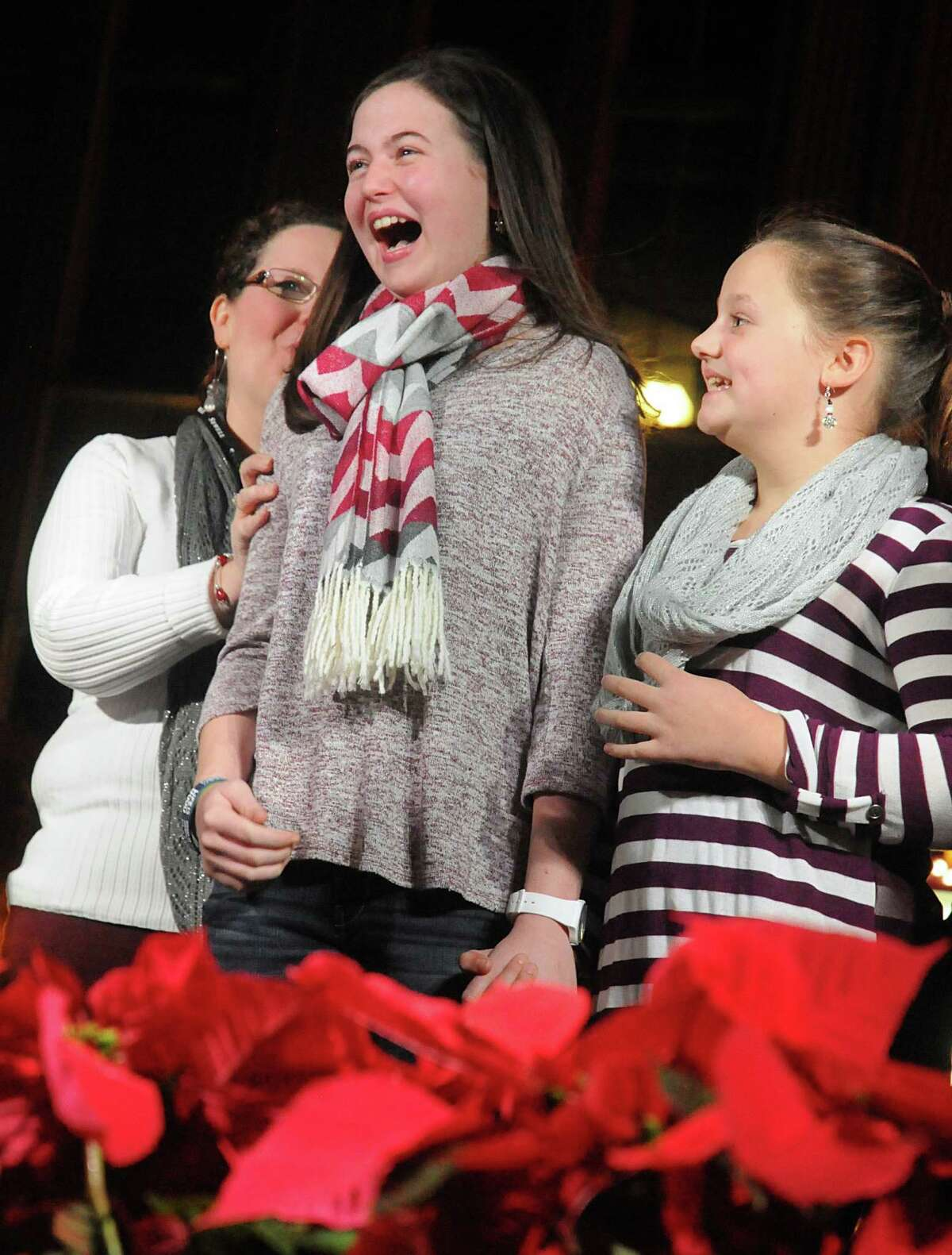 Anna King of The Woodlands, reacts after learning Tiffany and Company in Market Street was giving her a present during the Market Street Christmas tree lighting ceremony at Central Park in Market Street. King, 14, a recent heart transplant recipient was the honored guest at the ceremony.
