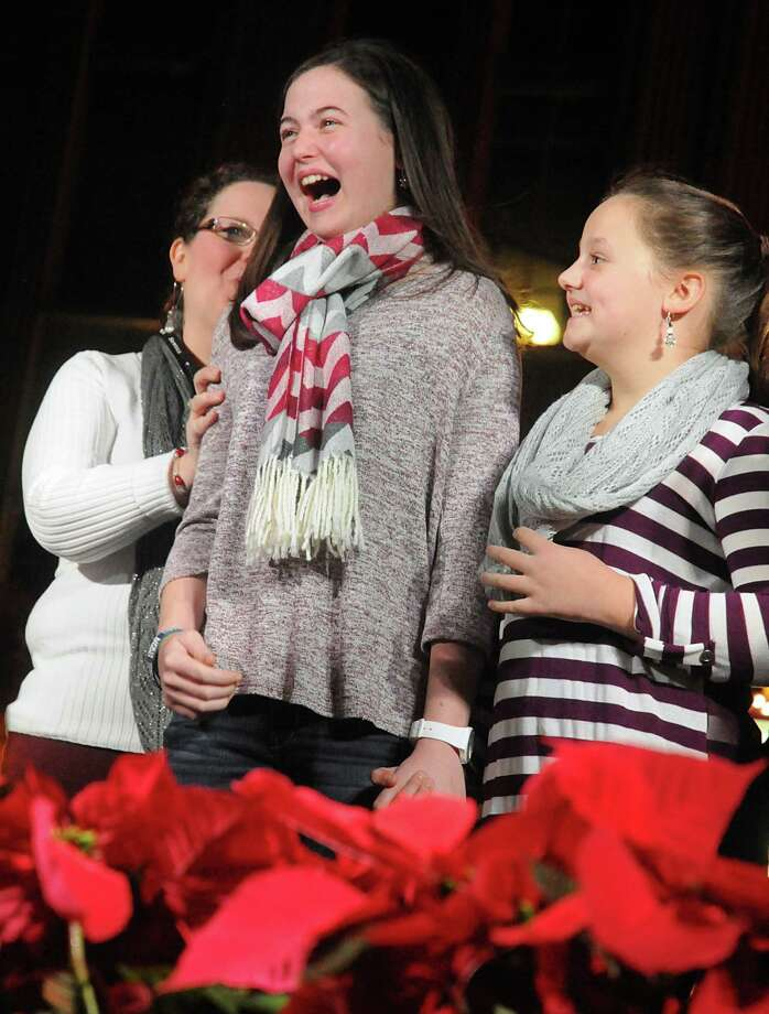 Anna King of The Woodlands, reacts after learning Tiffany and Company in Market Street was giving her a present during the Market Street Christmas tree lighting ceremony at Central Park in Market Street. King, 14, a recent heart transplant recipient was the honored guest at the ceremony. Photo: David Hopper, Freelance / freelance