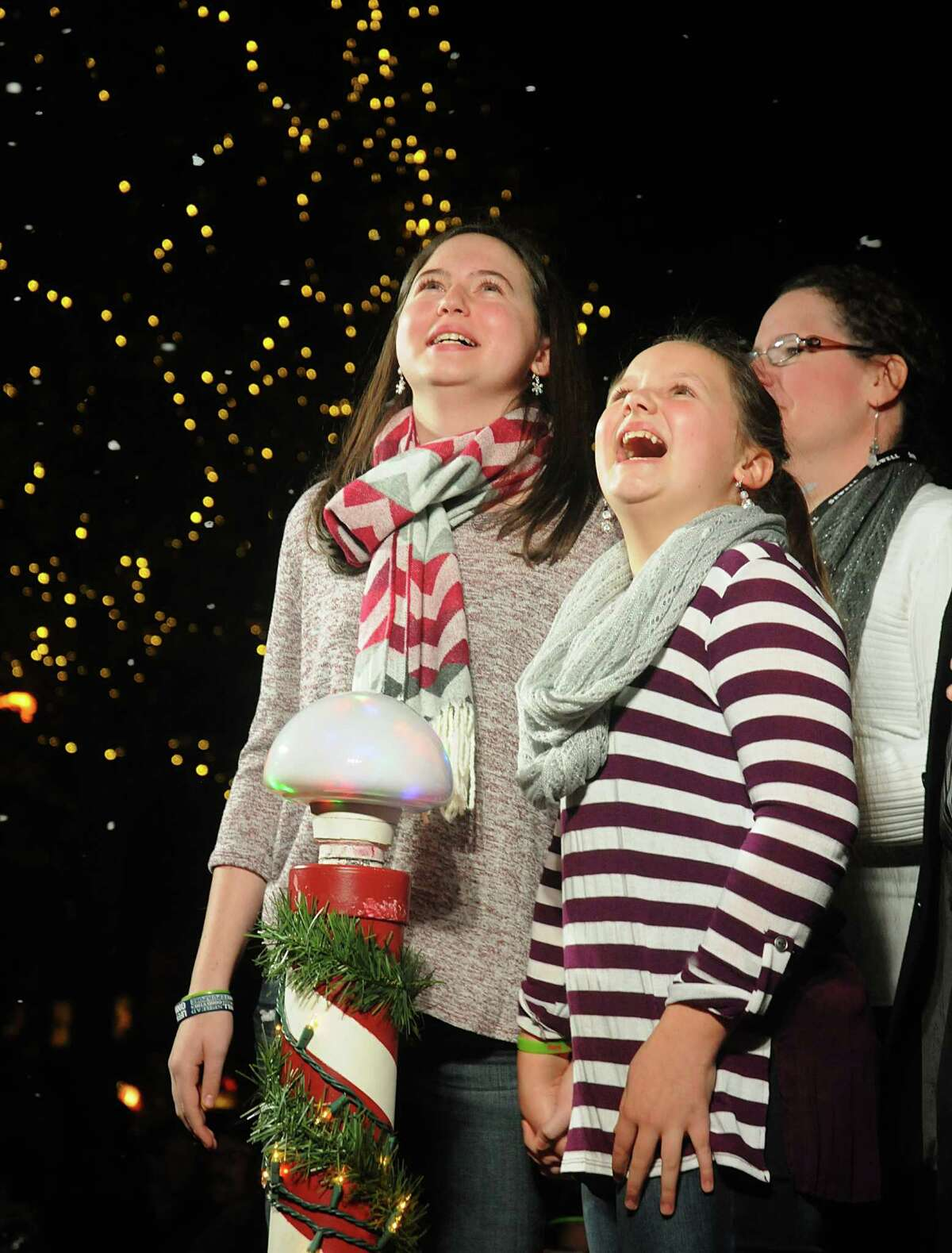 Anna King of The Woodlands, her sister, Lila, and mother Pam admire the 70-foot tall lighted Christmas tree during the Market Street Christmas tree lighting ceremony at Central Park in Market Street. King, a recent heart transplant recipient was the honored guest.