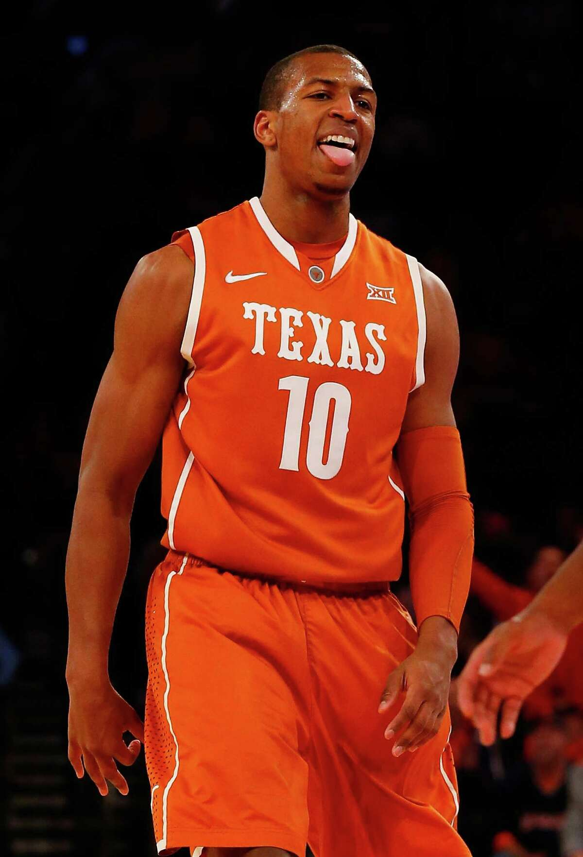 NEW YORK, NY - NOVEMBER 20: Jonathan Holmes #10 of the Texas Longhorns celebrates after hitting a three-pointer against the Iowa Hawkeyes during the 2K Classic at Madison Square Garden on November 20, 2014 in New York City.
