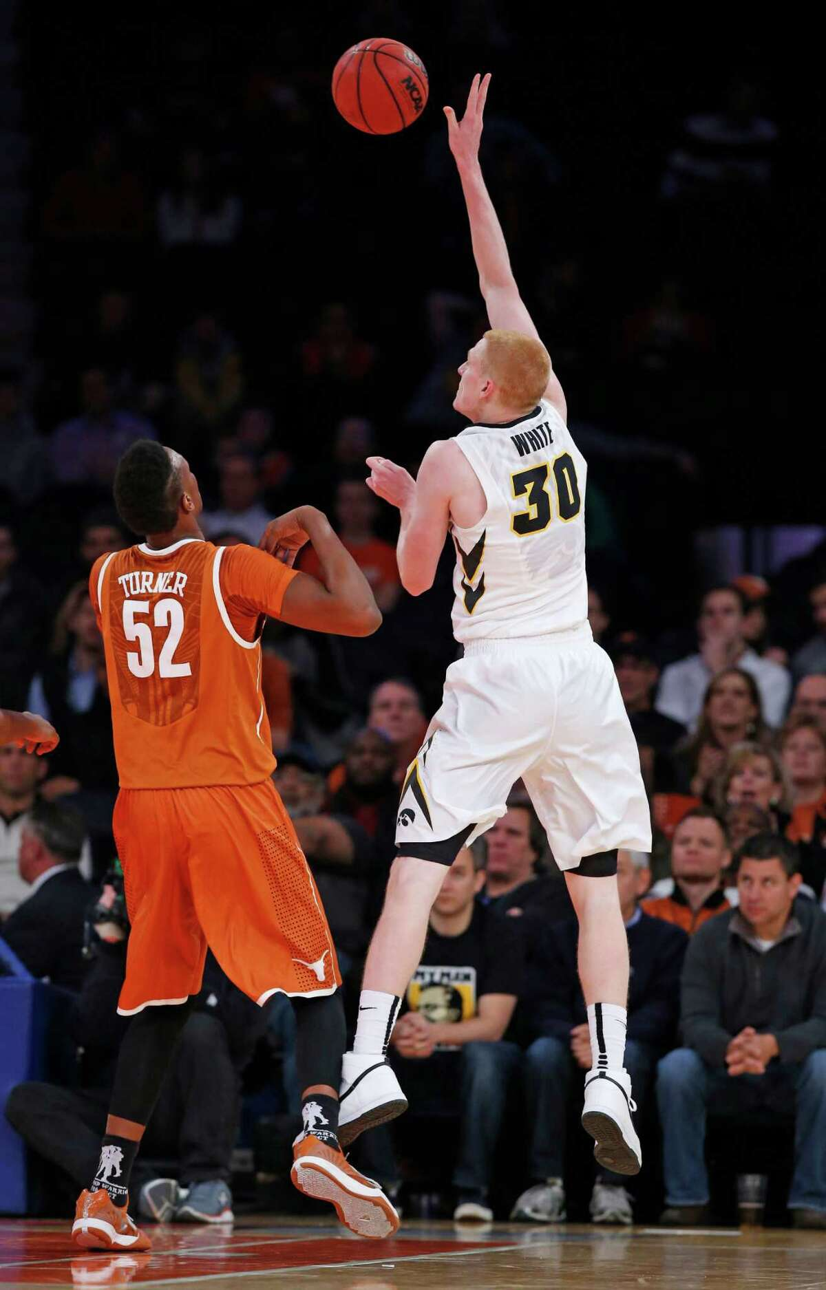 Iowa forward Aaron White (30) shoots over Texas forward Myles Turner (52) in the first half of an NCAA basketball game at Madison Square Garden in New York, Thursday, Nov. 20, 2014. (AP Photo/Kathy Willens)
