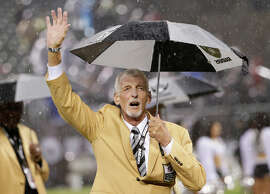 Hall of Fame punter Ray Guy acknowledges the crowd during a halftime ceremony Thursday.