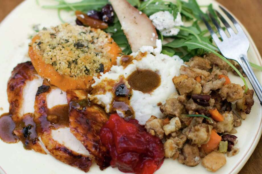 FILE- This Oct. 8, 2012, file photo shows a Thanksgiving dinner plate of cider brined turkey with sage gravy, peach cranberry sauce, sour cream and chive mashed potatoes, sausage pecan stuffing, arugula pear salad with pomegranate vinaigrette and goat cheese and herb crusted sweet potatoes in Concord, N.H. (AP Photo/Matthew Mead, File) ORG XMIT: NY721 Photo: Matthew Mead / FR170582