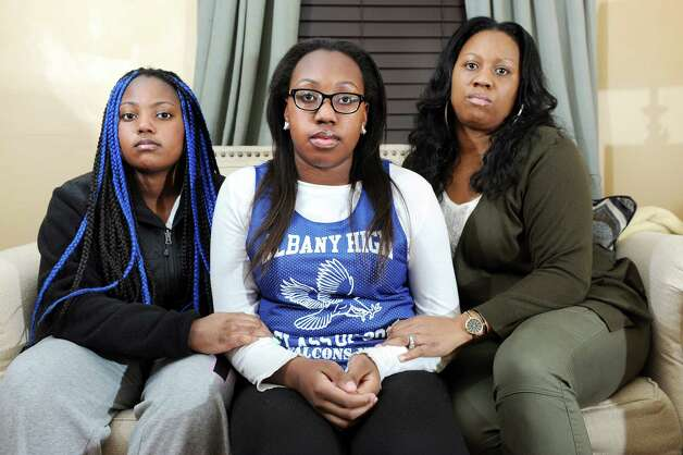 Kori Dobbs, 17, center, with her sister Camille Dobbs, 14, left, and their mother Selina Dobbs on Thursday, Nov. 20, 2014, at their home in Albany, N.Y. Kori was recently elected Senior Class President and has faced ugly, racist harassment on Twitter and social media. (Cindy Schultz / Times Union) Photo: Cindy Schultz / 00029579A