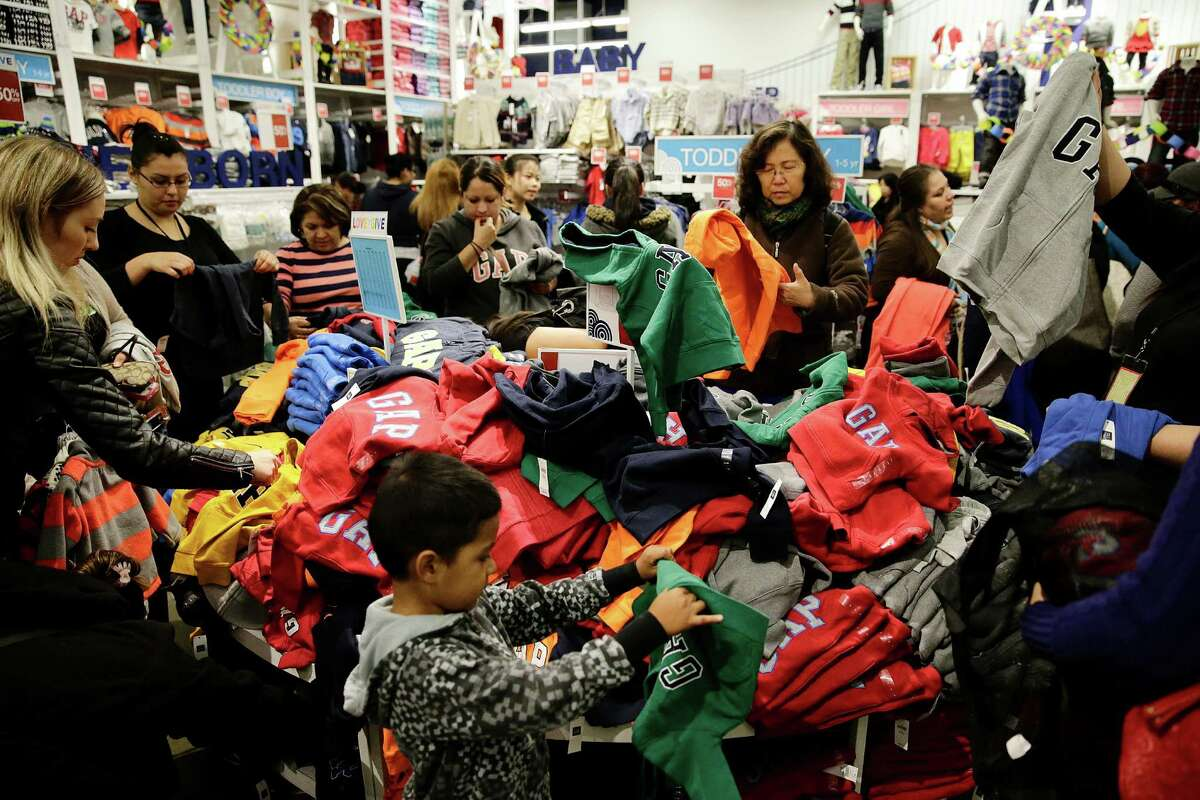 People shop at a Gap factory store at the Citadel Outlets in Los Angeles on Nov. 28, 2013. Americans are expected to spend at the highest rate in three years during what's traditionally the busiest shopping season of the year, the National Retail Federation said.