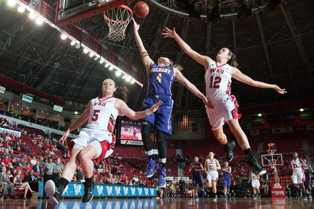 UAlbany's Sarah Royals goes to the basket between Western Kentucky defenders Micah Jones, left, and Kendall Noble during their preseason WNIT semifinal on Thursday, Nov. 20, 2014. (Joshua Lindsey / Special to the Times Union)