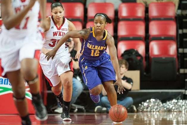 UAlbany guard Imani Tate dribbles up the court against Western Kentucky during their preseason WNIT semifinal at Western Kentucky on Thursday, Nov. 20, 2014. (Joshua Lindsey / Special to the Times Union)