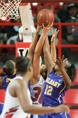 Imani Tate, right, of UAlbany battles for the ball with a Western Kentucky player during their preseason WNIT game at Western Kentucky on Thursday, Nov. 20, 2014. (Joshua Lindsey / Special to the Times Union)
