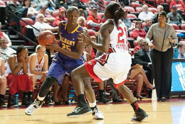 UAlbany's Shereesha Richards attempts to drive past Alexis Govan of Western Kentucky during their preseason WNIT semifinals at Western Kentucky on Thursday, Nov. 20, 2014. (Joshua Lindsey / Special to the Times Union)
