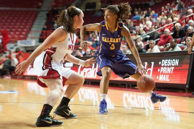 Margarita Rosario of UAlbany looks for a way to get past Western Kentucky's Micah Jones during their preseason WNIT semifinal at Western Kentucky on Thursday, Nov. 20, 2014. (Joshua Lindsey / Special to the Times Union)