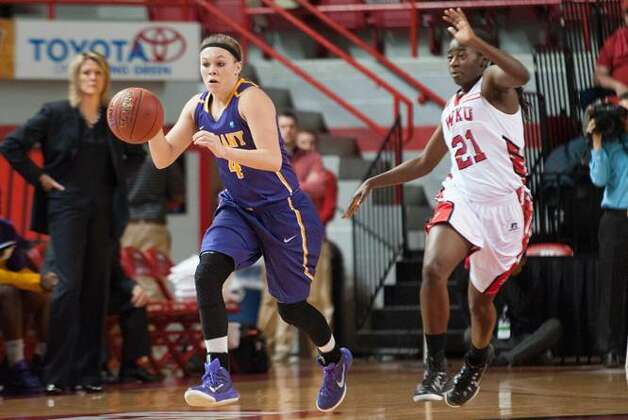Sarah Royals of UAlbany dribbles past Western Kentucky's Alexis Govan during their preseason WNIT semifinal at Western Kentucky on Thursday, Nov. 20, 2014. (Joshua Lindsey / Special to the Times Union)