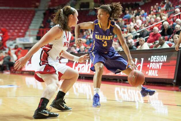 UAlbany's Margarita Rosario looks to get past Western Kentucky's Micah Jones during the semifinals of the preseason WNIT at E.A. Diddle Arena in Bowling Green, Ky. (Joshua Lindsey / WKU Athletics) Photo: Joshua Lindsey / Copyright 2014 WKU Athletics