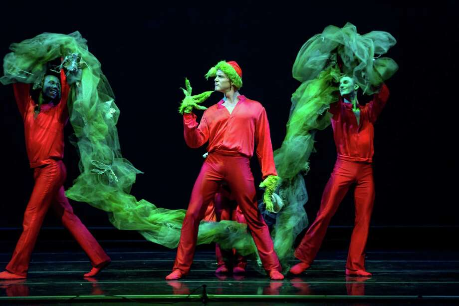 """Dustin James (left) and Kevin James (right) flank Robert Moore, who is the featured bad-guy in """"Mean and Green,"""" a new work choreographed by Weston Krukow for Smuin Ballet's """"The Christmas Ballet, Uncorked!"""" Photo: Keith Sutter / ONLINE_YES"""