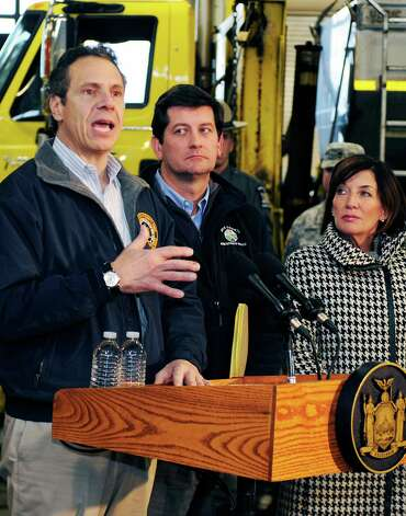Governor Andrew M. Cuomo, left, speaks with the media as Erie County Executive Mark Poloncarcz, center, and Lt. Gov.Kathy Hochul, right, listen during a storm briefing at the Thruway Authority in Cheektowaga, N.Y. Wednesday, Nov.19, 2014. The Buffalo area found itself buried under as much as 5½ feet of snow Wednesday, with another lake-effect storm expected to bring 2 to 3 more feet by late Thursday. (AP Photo/Gary Wiepert) ORG XMIT: NYGW116 Photo: Gary Wiepert / FR170498 AP