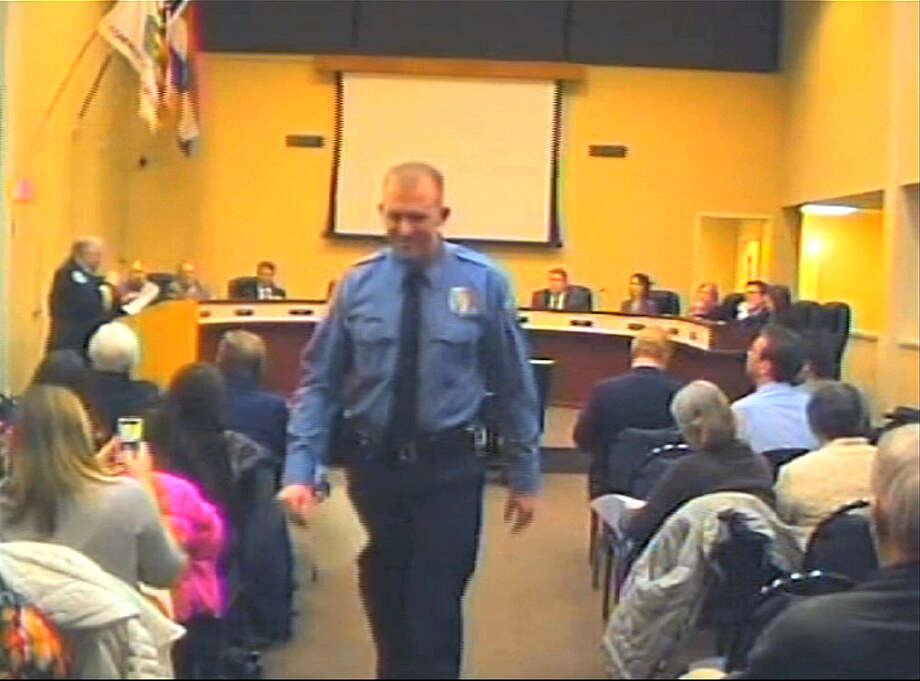 FILE - In this  Feb. 11, 2014 file image from video provided by the City of Ferguson, Mo., officer Darren Wilson attends a city council meeting in Ferguson. Wilson is not expecting to face criminal charges from a Missouri grand jury that has been investigating the nationally watched case for the past several months, a police union official said Thursday, Nov. 20, 2014. Jeff Roorda, the business manager for the St. Louis Police Officers' Association, said he met Thursday with Ferguson Police Officer Wilson, who has remained secluded from the public eye since the Aug. 9 shooting. Wilson remains confident in the outcome of the grand jury investigation, Roorda said.    (AP Photo/City of Ferguson, File) ORG XMIT: NY130 Photo: Uncredited / City of Ferguson