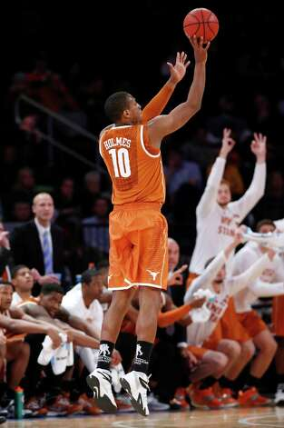 Texas forward Jonathan Holmes (10) shoots a three-pointer in the second half of an NCAA basketball game against Iowa at Madison Square Garden in New York, Thursday, Nov. 20, 2014. Texas defeated Iowa 71-57.  Holmes was the high scorer in for Texas with 19 points. (AP Photo/Kathy Willens) ORG XMIT: MSG110 Photo: Kathy Willens / AP